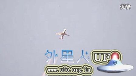 2014年10月3日拍到飞机和UFO同时出现在空中的图片