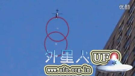 2014年10月5日两个悬停空中的UFO被美国纽约直升机追逐的图片
